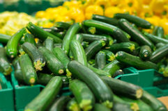 Bunch of zucchini on boxes in supermarket Stock Image