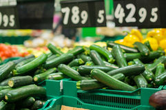 Bunch of zucchini on boxes in supermarket Royalty Free Stock Photography