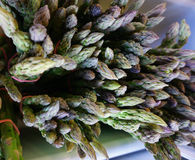 Bunched asparagus in the market for sale. Organic bunched asparagus at the market on display for sale stock images