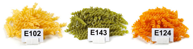 Bunches of artificially colored pasta Stock Image