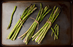 Bunches of Asparagus on Cooking Sheet Royalty Free Stock Photo