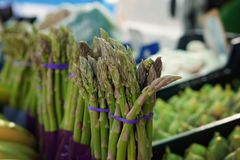 Bunches of asparagus on the counter in the vegetable market in Spain Stock Photo