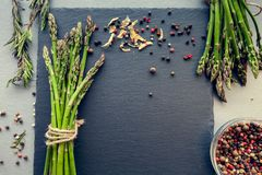 Bunches of asparagus with spices Royalty Free Stock Photography