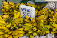 Bunches of banana on table in market Stock Photography