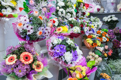 bunches of big fresh orange pink red gerbera chamomile and big white yellow blue chrysanthemum flower Royalty Free Stock Photography