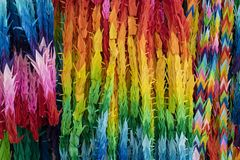 Bunches of colorful Origami paper crane birds. Full frame stock photo