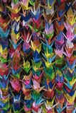 Bunches of colorful Origami paper crane birds full frame. Close up stock photos