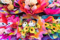 Bunches of cute soft toys with flowers Royalty Free Stock Images
