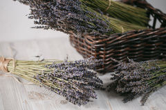 Bunches of dried lavender in backet on wooden background Royalty Free Stock Images
