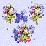 Bunches of flowers on a violet background. Bunches of colorful  flowers on a violet background Stock Photos