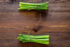 Bunches of fresh asparagus sprouts on dark wooden background top view copyspace royalty free stock photography