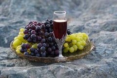 Bunches of grape on the rocks royalty free stock photo