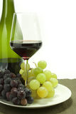Bunches of grapes. Bunches of black and white grapes bottle and glass Stock Photos