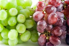 Bunches of grapes. Red and Green Grapes Stock Photos