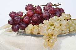 Bunches of grapes on a glass dish  Royalty Free Stock Photos