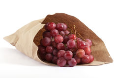 Bunches of grapes in paper bag Royalty Free Stock Images