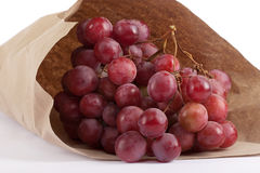 Bunches of grapes in paper bag Stock Photography