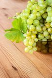 Bunches of green grapes in a Cup. Bunches of grapes in a bowl on the table royalty free stock photos