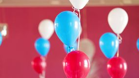 Bunches Of Helium Balloons Decorating Room stock footage
