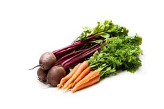 Bunches  of new carrots  and beetroots isolated on white. Bunches  of new carrots and beetroots isolated on white Stock Photo
