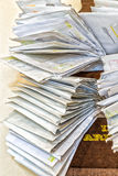 Bunches of old bills and accounts  in dusty original envelopes Stock Image
