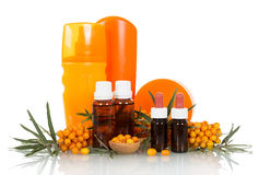 Bunches of sea buckthorn and cosmetic products based on it isolated  white Royalty Free Stock Photos