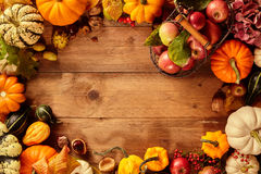 Bunches of squash around blank area on table Royalty Free Stock Images
