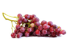 Bunches of Summer fresh red grape. With white isolate background Royalty Free Stock Image
