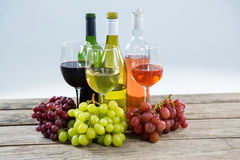 Bunches of various grapes with wine glass and bottles Royalty Free Stock Photography