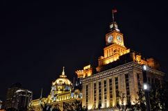 Bund at night. Hong Kong and Shanghai Bank and Customs House with clock tower on Bund at night, Shanghai, China Stock Image