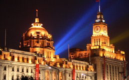 The Bund by night. Night view on the customs house and an old colonial bank on the Bund in Shanghai (both buildings date from beginning 20th century Stock Photography