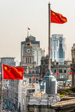 The bund rooftops and chineses flags shanghai china Stock Image