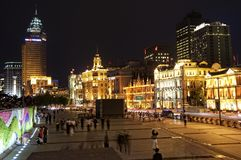 The Bund Shanghai, China. SHANGHAI, CHINA - MAY 5, 2015: Visitors on The Bund or Waitan at night. Shanghai's Bund has dozens of historical buildings and is one Stock Images
