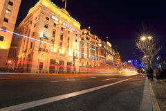 The bund in shanghai at night. Light trails on the street with classical buildings Stock Photography
