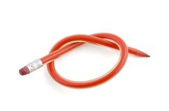 Bunden upp röd böjlig blyertspenna som isoleras på vit Royaltyfria Foton