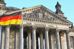 Bundestag in Berlin & german flag Stock Image