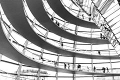 Bundestag glass dome windows architecture design. Bundestag building unique glass dome design windows, black and white tourists shadows silhouettes, Berlin royalty free stock photography