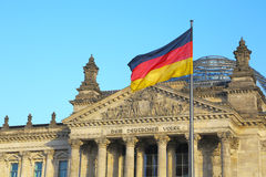 Bundestag & huge german flag in Berlin Royalty Free Stock Photos