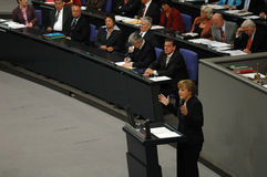 Bundestag No Confidence Vote 2005. JULY 1, 2005 - BERLIN: Angela Merkel (in the foreground) and Gerhard Schroeder - parliamentary debate before the no-confidence royalty free stock images