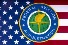 Bundesverwaltung für Luftfahrt-Logo und US-Flagge lizenzfreie stockbilder