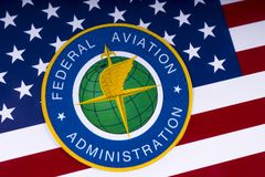 Bundesverwaltung für Luftfahrt-Logo und US-Flagge stockbild