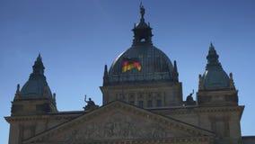 Waving German flag over the Federal Administrative Court building. Bundesverwaltungsgericht or Federal Administrative Court stock video footage