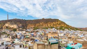Bundi cityscape, travel destination in Rajasthan, India. The majestic fort perched on mountain slope overlooking the blue city.  W. Ide angle view Royalty Free Stock Photos