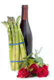 Bundle of asparagus with roses and wine bottle Royalty Free Stock Photography