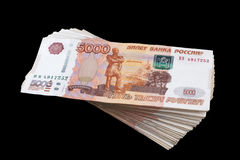Bundle of banknotes five thousand Russian rubles. Bundle of banknotes of five thousand Russian rubles on black background Stock Image