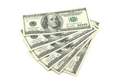 A bundle of bills in one hundred American dollars. On a white background Royalty Free Stock Photo
