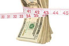 Bundle of cash getting squeezed Royalty Free Stock Photography
