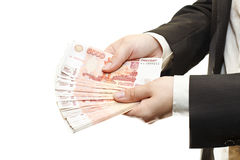 Bundle of cash in hands of businessman Stock Images