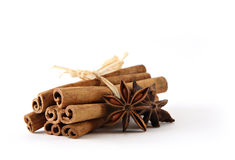 Bundle of cinnamon sticks. With star anis isolated on white Stock Image