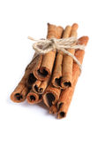 Bundle of cinnamon sticks. Isolated on white Royalty Free Stock Photo